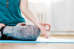 Yoga meditation in light room, lotus position, jnana mudra Stock Image
