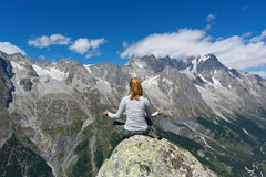 Yoga meditation in mountain top Stock Photography