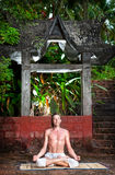 Yoga meditation near the temple Royalty Free Stock Photos