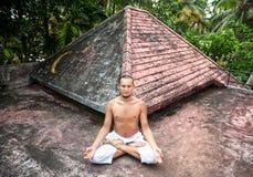 Yoga meditation on the roof Stock Photos