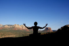 Yoga Meditation at Sedona. A woman in a yoga meditation pose near scenic sedona arizona Royalty Free Stock Images