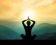 Yoga and meditation. Silhouette. Yoga and meditation. Silhouette of man in the mountain stock photo