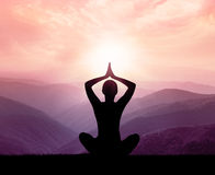 Yoga and meditation. Silhouette. Stock Photo