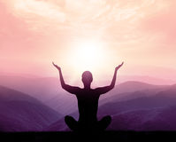 Yoga and meditation. Silhouette. Yoga and meditation. Silhouette of man in the mountain royalty free stock images