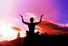 Yoga and meditation. Silhouette in mountains. Yoga and meditation. Silhouette of girl in mountains stock photo