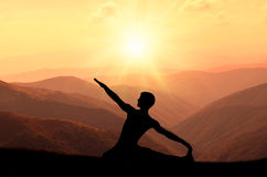 Yoga meditation silhouette pose Royalty Free Stock Photo
