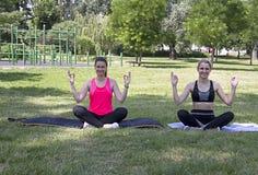 Yoga meditation at street in park.Europe.Serbia.Novi Sad. Yoga meditation, Young beautiful girls meditate in the park stock images