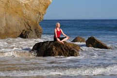 Yoga meditation at sunny beach Stock Photo