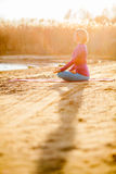 Yoga meditation, woman on sunset Royalty Free Stock Images