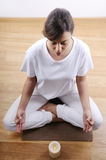 Yoga and meditation of young woman. In indoor Royalty Free Stock Photography