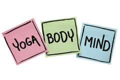 Yoga, mind, and body word abstract. Handwriting in black ink on sticky notes isolated on white stock photos