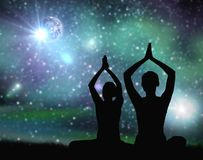 Black silhouette of couple meditating over space Stock Image