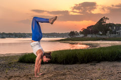 Yoga Model Doing a Handstand On Beach at Sunset Royalty Free Stock Images