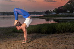 Yoga Model doing Headstand Scorpion Variation Beach Royalty Free Stock Photography