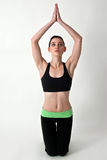 Yoga model kneeling Stock Photos