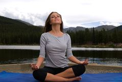 Yoga on a mountain Stock Photo