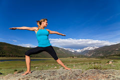 Yoga in the mountains Stock Photo