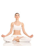 Yoga, mujer en la posición de loto Foto de archivo libre de regalías