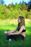 Yoga in nature. Young girl practicing yoga in nature Stock Images