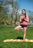 Yoga in a nature background. Balancing Pose Stock Images