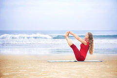 Yoga naukasana boat pose Stock Images