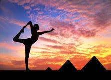 Yoga near Egyptian Pyramids Royalty Free Stock Photos