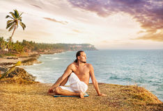 Yoga near the ocean Royalty Free Stock Photo