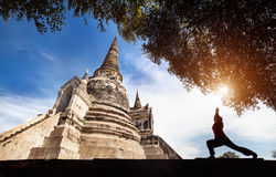 Yoga near temple in Thailand Stock Image