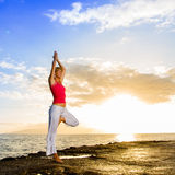 Yoga by the Ocean Royalty Free Stock Photography