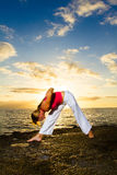 Yoga by the Ocean. Yoga woman practising her strength and balance Stock Images