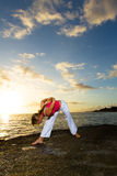 Yoga by the Ocean. Yoga woman practising her strength and balance royalty free stock photography