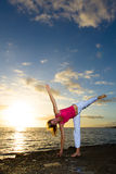 Yoga by the Ocean. Yoga woman practising her strength and balance Royalty Free Stock Photo