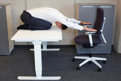 Yoga in office. Royalty Free Stock Photo
