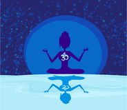 Yoga with ohm symbol over moon Stock Photography
