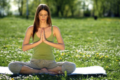 Yoga outdoors. Young women practicing yoga in the outdoor Stock Photo