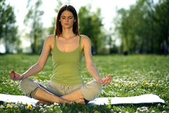 Yoga outdoors. Young women practicing yoga in the outdoor Royalty Free Stock Photos
