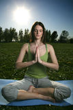 Yoga outdoors. Young women practicing in the outdoor Royalty Free Stock Images