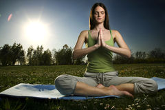 Yoga outdoors. Young women practicing yoga in the outdoor Stock Images