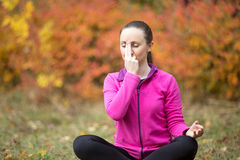 Yoga outdoors: Alternate Nostril Breathing Royalty Free Stock Photos