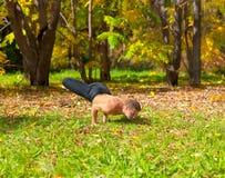 Yoga Padma mayurasana pose Stock Photos