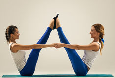 Yoga in pair. Buddy boat pose. Balance Royalty Free Stock Photo
