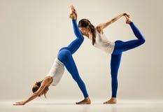 Yoga in pair. couple women. Duo Pose Stock Photo