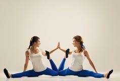 Yoga in pair. partner splits Stock Photo