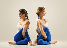 Yoga in pair. Partner twist Stock Image