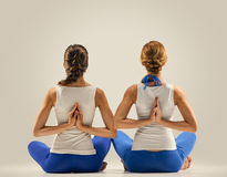 Yoga in pair. stretching. back. seated Stock Photo
