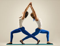 Yoga in pair. stretching back. standing Royalty Free Stock Photo