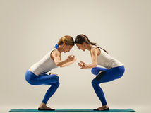 Yoga in pair. women. Duo. Balance on one leg Royalty Free Stock Photos