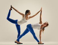 Yoga in pair. women. Duo. Balance Royalty Free Stock Image