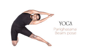 Yoga parighasana beam pose. By Indian man in black cloth isolated at white background. Free space for text and can be used as template for web-site Stock Image