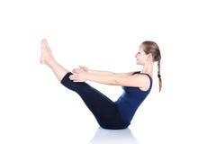 Yoga paripurna navasana Haltung lizenzfreies stockfoto